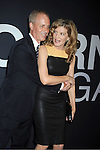 "actress Rene Russo and husband Dan Gilroy attend the World Premiere of ""The Bourne Legacy"" on July 30, 2012 at The Ziegfeld Theatre in New York City. The movie stars Jeremy Renner, Rachel Weisz, Edward Norton, Stacy Keach, Dennis Boutsikaris and Oscar Isaac."
