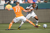 LA Galaxy forward Tristan Bowen (17) moves past Houston Dynamo defender Andrew Hainault (31) on his way to the goal. The LA Galaxy defeated the Houston Dynamo 4-1 at Home Depot Center stadium in Carson, California on Saturday evening June 5, 2010..