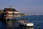 SeaPort Village restaurant with water taxi along San Diego bay with sailboats in the background, San Diego, California USA