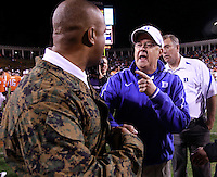 CHARLOTTESVILLE, VA- NOVEMBER 12:  Head coach Mike London of the Virginia Cavaliers, left, has words with head coach David Cutcliffe of the Duke Blue Devils after the game on November 12, 2011 at Scott Stadium in Charlottesville, Virginia. Virginia defeated Duke 31-21. (Photo by Andrew Shurtleff/Getty Images) *** Local Caption *** Mike London;David Cutcliffe