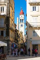 Street scene by Spianada and Church of Saint Spyridon with traditional clock belltower in Kerkyra, Corfu Town, Greece