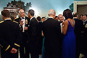 United States President Barack Obama talks with General Raymond Odierno, Chief of Staff of the U.S. Army, as First Lady Michelle Obama talks with Vice President Joe Biden and Gen. Martin Dempsey, Chairman of the Joint Chiefs of Staff, during a Department of Defense dinner in the Diplomatic Reception Room of the White House, February 29, 2012. The President and First Lady hosted the dinner to honor members of the Armed Forces who served in Operation Iraqi Freedom and Operation New Dawn, and to honor their families.  .Mandatory Credit: Pete Souza - White House via CNP