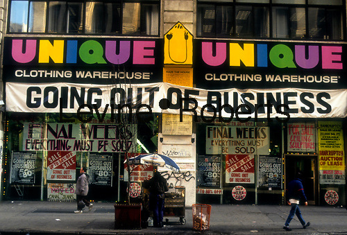 Unique Clothing Warehouse going out of business seen on Broadway in New York in 1991.  (© Richard B. Levine)