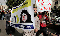 A protest by muslims demanding the release of a woman they said was detained by authorites following having converted from Christianity to Islam. Kamilia Shehata Zakher (born 1985) is a school teacher Deir Mawas, Egypt and the wife of Tadros Samaan, the Coptic Priest of Saint Mark's Church in Mowas Cathedral in Minya.Her disappearance in July 2010 sparked protests, rumours of kidnapping and forced conversion to Islam and subsequent forcible return to the Church-inflamed sectarian tensions between Egypt's Muslim majority and Coptic Christian minority.