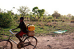 A boy bringing back water from the pond. Families are supposed to filter water at home before drinking it.. Gburumani, Northern Region, Ghana.