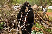 refugee child collecting firwood in Makpandu camp, South Sudan