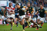 Handre Pollard of South Africa takes on the Japan defence. Rugby World Cup Pool B match between South Africa and Japan on September 19, 2015 at the Brighton Community Stadium in Brighton, England. Photo by: Patrick Khachfe / Onside Images