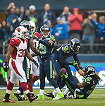 Seattle Seahawks cornerback Jeremy Lane helps cornerback Richard Sherman up from the turffafter he intercepted a pass thrown by Arizona Cardinals quarterback Carson Palmer during the second quarter at CenturyLink Field in Seattle, Washington on December 22, 2013.   The Cardinals beat the Seahawks 17-10.  ©2013. Jim Bryant Photo. ALL RIGHTS RESERVED.