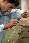 Earthquake survivor Abdul Wahab learns masonry at a skills training center in Battagram, Pakistan, sponsored by Church World Service. The program trains quake survivors in construction skills like carpentry, plumbing, welding, electrical, and masonry.
