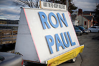 A car pulls a trailer sign in support of Ron Paul on which is also printed the words &quot;Audit the Fed&quot; and &quot;Occupy Wall Street&quot; outside a Ron Paul town hall meeting and rally at the Church Landing at Mills Falls hotel in Meredith, New Hampshire, on Jan. 8, 2012. Paul is seeking the 2012 Republican presidential nomination.