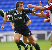2005/06 Guinness Premiership Rugby, London Irish vs Bristol Rugby; Exiles, wing Justin Bishop, hand off, as he attacks. Madejski Stadium, Reading, ENGLAND 24.09.2005   © Peter Spurrier/Intersport Images - email images@intersport-images..
