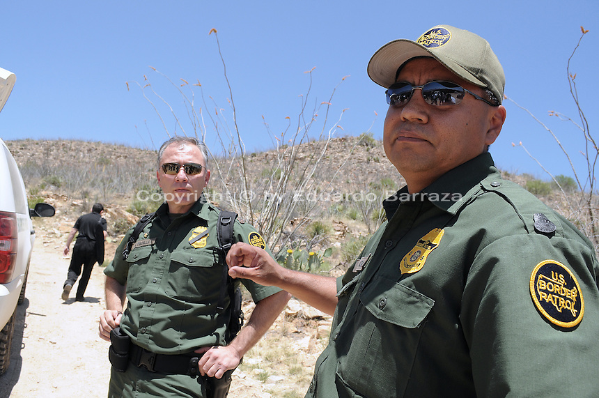 Sasabe, Arizona – Deputy Chief Patrol Agent Tucson Sector Border Patrol Manuel Padilla, Jr. (left), and Andy Adame, Special Operations Supervisor, talk to reporters before taking them for a walk through the desert. U.S. Customs Border Protection (CBP) transported journalists to this remote area where they walked through a 1.3 miles trail during a two-day event organized by the Tucson Sector Border Patrol. The event brought national and international journalists to the Arizona desert to become acquainted with the dynamics of this area. This area is located near the Sasabe Port of Entry, a border-crossing station located in southern Arizona, and about 70 miles from the City of Tucson. Sasabe is one of the most isolated ports along the 2,000-mile U.S.-Mexico border, and it connects the towns of Sasabe, Arizona and El Sasabe, Sonora (Mexico). The border-crossing station is located in one of the busiest human and drug smuggling corridors of the U.S.-Mexico border. Photo by Eduardo Barraza © 2012