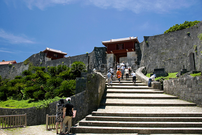 """Visitors walk down the steps from Zuisenmon gate inside the grounds of Shuri-jo Castle  in Naha, Okinawa Prefecture, Japan, on May 28, 2012. Zuisenmon, which means """"splendid and auspicious spring,"""" takes its name from the Ryuhi"""" spring just in front of it."""