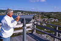 Newfoundland and Labrador, Canada - Woman looking through Scope at Rose Blanche Lighthouse, Western Region (Model Released)