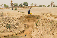Collecting Water. Scarce water supplies during the dry season. Katsina State, Nigeria.