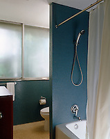 Totally opaque sliding windows means there is no need for blinds or other window treatments in this bathroom