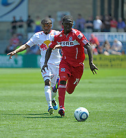 Chicago midfielder Patrick Nyarko (14) dribbles away from New York midfielder Dane Richards (19).  The Chicago Fire tied the New York Red Bulls 1-1 at Toyota Park in Bridgeview, IL on June 26, 2011.