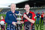 Kenmare Captain Rob Hobnett receives the Barrett cup from Christy Lehane after defeating St Mary's in the final in Fitzgerald Stadium on Sunday