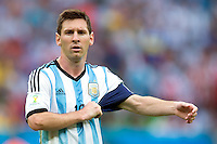 Lionel Messi of Argentina pulls at his captains armband