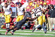 College Park, MD - OCT 15, 2016: Minnesota Golden Gophers running back Shannon Brooks (23) avoids the tackle by Maryland Terrapins defensive back Qwuantrezz Knight (24) during game between Maryland and Minnesota at Capital One Field at Maryland Stadium in College Park, MD. (Photo by Phil Peters/Media Images International)