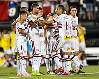 Orlando, FL - Saturday Jan. 21, 2017: São Paulo midfielder Cícero (8) celebrates his successful penalty shot with his teammates during the penalty shootout of the Florida Cup Championship match between São Paulo and Corinthians at Bright House Networks Stadium. The game ended 0-0 in regulation with São Paulo defeating Corinthians 4-3 on penalty kicks.