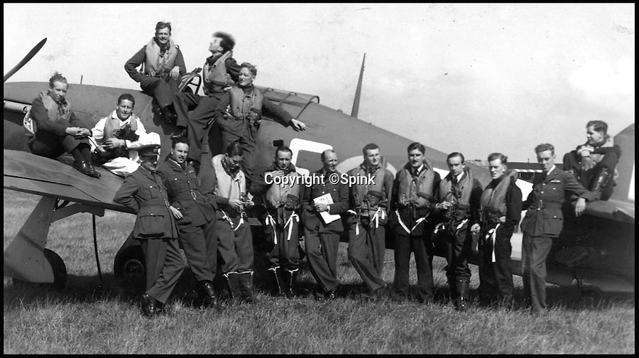 BNPS.co.uk (01202 558833)<br /> Pic: Spink/BNPS<br /> <br /> ***Please Use Full Byline***<br /> <br /> No. 242 Squadron, Manston, August 1941. Hamlyn is seated to the left of the cockpit, one hand in his pocket.<br /> <br /> The remarkable story of a prolific RAF hero who achieved 'ace' status in just two-and-a-half hours of flying has come to light after his medals were put up for sale.<br /> <br /> Squadron Leader Ronald Fairfax Hamlyn went up in his Spitfire three times on August 24, 1940, at the very height of the Battle of Britain.<br /> <br /> He was awarded the Distinguished Flying Medal which, along with the rest of his medals, is being sold in London for an estimated &pound;60,000.