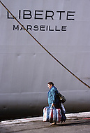 May 27,1989, Marseilles, France --- Muslim immigration in the port city of Marseille. Algerian passengers disembark Liberte ship. --- Image by © JP Laffont