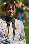 At Celebrate Earth Day at Nassau County Museum of Art, JOHN CLOUD KAISER, an artist from NYC art collective Free Style Arts Association, is wearing a white jacket and tie colorfully decorated by visitors.