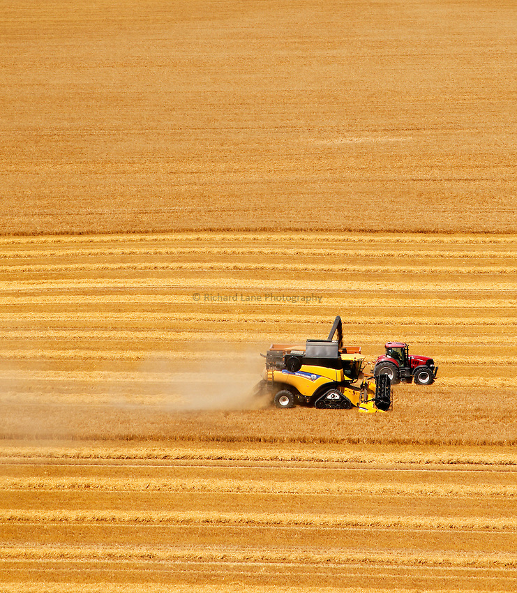 Photo: Richard Lane/Richard Lane Photography. New Holland combine harvester cutting winter barley near Pewsey, Wiltshire. 22/07/2014.