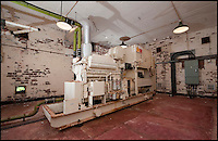 BNPS.co.uk (01202 558833)<br /> Pic: PhilYeomans/BNPS<br /> <br /> Generator room.<br /> <br /> Fed up with your neighbours...This Cold War bunker boasting 56 rooms, metre thick walls and no windows could be the perfect country retreat.<br /> <br /> The former top secret nuclear bunker on a remote Devon clifftop was built to shelter local officials in the chilling event of a Soviet strike on nearby Plymouth.<br /> <br /> The 30,000 sq ft shelter, built at the height of the Cold War in 1952, boasts heavy steel blast doors and its 375 kva generator can provide enough heat and light to keep up to 150 people safe for several months.<br /> <br /> It's 56 rooms were kitted out as bedrooms, living spaces, and mess rooms so that the administration could continue running the county even after a nuclear strike.<br /> <br /> Codenamed Hope Cove R6, it was finally decommissioned in 1999 and bought by local farmers Trevor Lethbridge and his friend Derek Brooking, who have used it as an archive storage system and a venue for charity and art events.<br /> <br /> The pair are now selling it through Clive Emson Auctioneers in Maidstone, Kent.