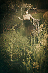 atmospheric photo of beautiful young caucasian woman on the meadow in retro style