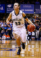 INDIANAPOLIS, IN - FEBRUARY 13: Chase Stigall #33 of the Butler Bulldogs dribbles the ball against the Charlotte 49ers at Hinkle Fieldhouse on February 13, 2013 in Indianapolis, Indiana. Charlotte defeated Butler 71-67. (Photo by Michael Hickey/Getty Images) *** Local Caption *** Chase Stigall