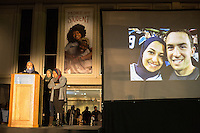 Images of Deah Barakat, 23, a UNC student and his wife, Yusor Abu-Salha, 21 are projected as friends speak to thousands who gathered for a vigil and memorial for three shooting victims at The Pit at The University of North Carolina at Chapel Hill in Chapel Hill, North Carolina on Wednesday, February 11, 2015. Craig Hicks, 46, of Chapel Hill has been charged with three counts of first-degree murder in the killings of Deah Barakat, 23, a UNC student; his wife, Yusor Abu-Salha, 21; and her sister, Razan Abu-Salha, 19. (Justin Cook)