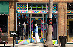 Woman entering a shop on Abbot Kinney Blvd. in Venice, California