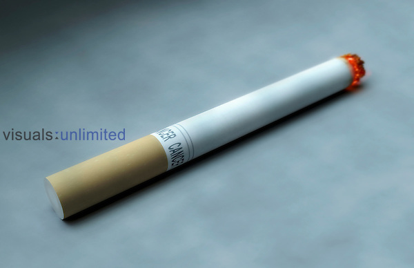 A lighting cigarette. Royalty Free