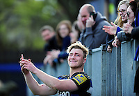 David Denton of Bath Rugby poses for a selfie with supporters after the match. Aviva Premiership match, between Bath Rugby and Sale Sharks on April 23, 2016 at the Recreation Ground in Bath, England. Photo by: Patrick Khachfe / Onside Images