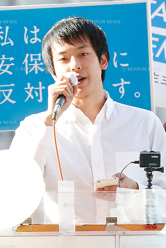 Nobukazu Honma, a member of SEALDs, Students Emergency Action for Liberal Democracy-s, attend a rally against new security legislation at Tokyo's Shinjuku district, Japan on January 5, 2016. The Civil Alliance for Peace and Constitutionalism, comprised of members from SEALDs and other organizations, held a new year public rally to demand repeal of contentious security laws and to call on opposition parties to ally in this summer's upper house election. (Photo by AFLO)