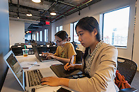 Jenny Jiao Hsia, right and Zlata Barshteyn, left,  collaborate on developing computer games at a game jam at NYU-Poly in downtown Brooklyn in New York on Sunday, September 29, 2013. With women making up only 4 percent of game developers the Code Liberation project at NYU-Poly invited women coders of different skill levels to participate in a weekend long game jam to encourage more women to enter the tech fields. Over 20 women participated, working in teams to develop their games.  (© Richard B. Levine)
