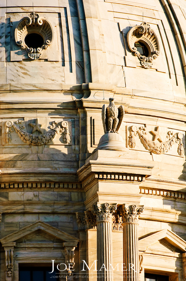 Minnesota State capitol building dome detail. The building was designed by Cass Gilbert. The unsupported dome is the second largest in the world, after Saint Peter's. Work began in on the capitol in 1896, and construction was completed in 1905. It is the third building to serve this purpose: the first capitol was destroyed by fire in 1881, and the second was completed in 1883, but was considered to be too small almost immediately...