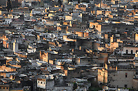 General view of the old Medina, Fez, Morocco, pictured on February 25, 2009 in the morning. Fez, Morocco's second largest city, and one of the four imperial cities, was founded in 789 by Idris I on the banks of the River Fez. The oldest university in the world is here and the city is still the Moroccan cultural and spiritual centre. Fez has three sectors: the oldest part, the walled city of Fes-el-Bali, houses Morocco's largest medina and is a UNESCO World Heritage Site;  Fes-el-Jedid was founded in 1244 as a new capital by the Merenid dynasty, and contains the Mellah, or Jewish quarter; Ville Nouvelle was built by the French who took over most of Morocco in 1912 and transferred the capital to Rabat. Picture by Manuel Cohen.