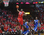 Ole MIss forward Reginald Buckner (2)  dunks as Kentucky's DeAndre Liggins (34) and Kentucky's Terrence Jones (3)  defend at the C.M. &quot;Tad&quot; Smith Coliseum in Oxford, Miss. on Tuesday, February 1, 2011. Ole Miss won 71-69.