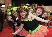 NO REPRO FEE: 28.1.12: Pictured were Over 55's accompanied by The Dancerite dance school from Rathcoole, Dublin who took part in the organisd Conga Line at the Holiday World Show at the RDS Simmonscourt. New to this year is the Over 55's Holiday show, joining The Holiday World Show and The Caravan and Motorhome Show, offering three great shows in one. The Show runs until 5.30pm on Sunday 29th January. Pictured was Niamh Ready (age 8) with her dance friends from Dancerite, Rathcoole. Picture Collins Photos.