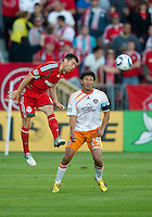 01 July 2010:  Houston Dynamo forward Brian Ching #25 and Toronto FC defender Dan Gargan #8 in action during a game between the Houston Dynamo and the Toronto FC at BMO Field in Toronto..Final score was 1-1....