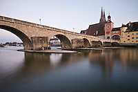 12th century stone bridge crosses the Danube river, Regensburg, Germany