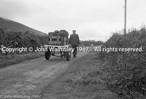 "Donkey cart, Dunquin (in Gaelic, Dún Chaoin, meaning ""Caon's stronghold""), on the tip of the Dingle Peninsula, County Kerry, Ireland.  1971."