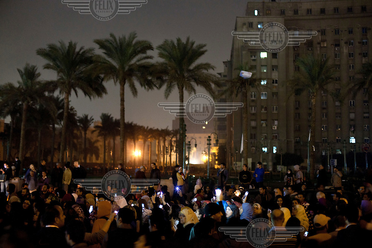 Women march at night demanding an end to military rule and to protest an incident where female demonstrators were beaten by soldiers..