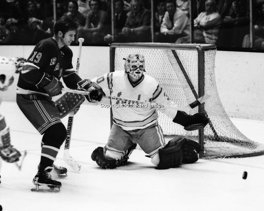 "Seals vs New York Rangers..Rangers Jean Ratelle and Seals goallie Gary Simmons ""The cobra"" (1974 photo  by Ron Riesterer)"