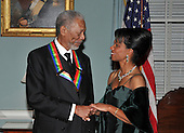 Washington, DC - December 6, 2008 -- Morgan Freeman, left, and United States Secretary of State Condoleezza Rice converse after posing for the formal group photo following the Artist's Dinner at the United States Department of State in Washington, D.C. on Saturday, December 6, 2008 to honor 2008 recipients of the Kennedy Center Honors..Credit: Ron Sachs - Pool via CNP