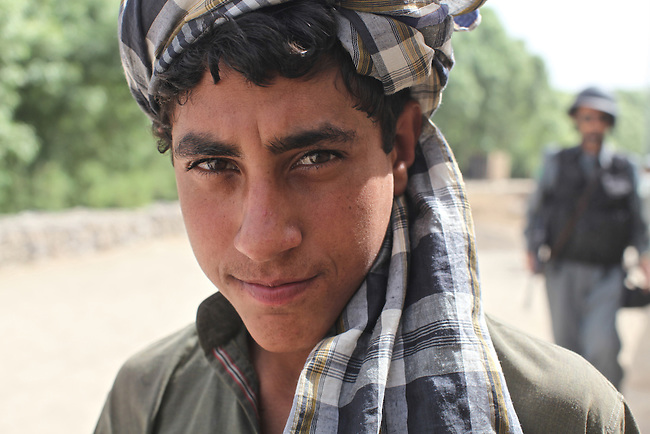 A young man poses briefly for a portrait in the village of Deh-e- Chowkay, in the Arghandab valley near Kandahar, Afghanistan. May 23, 2010. DREW BROWN/STARS AND STRIPES