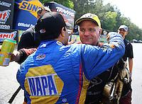 May 17, 2015; Commerce, GA, USA; Funny car runner-up, Ron Capps congratulates NHRA funny car driver Tim Wilkerson celebrate after winning the Southern Nationals at Atlanta Dragway. Mandatory Credit: Mark J. Rebilas-USA TODAY Sports